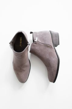 """- Classic faux suede ankle booties - Side zippers - Small 2"""" back cut-out heel - Lightly padded insole - True to US size - All man made material - Imported"""