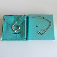 "Tiffany & Co. Elsa Peretti's Open Heart Necklace Authentic Tiffany & Co. Classic Elsa Peretti open heart pendant. Elsa Peretti's most celebrated icon. Pendant in sterling silver. Size medium, on a 16"" chain. Perfect condition. Comes with pouch and box. Orig $275 + tax comes out to be around $300. Tiffany & Co. Jewelry Necklaces"
