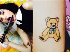 O Teddy Bear não poderia faltar. Está em um dos braços e foi feito em Setembro de 2014.