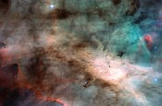 5000 light years away, in the famous star-forming region of Omega Nebula, stars continue to form. The dark dust in the center were created in the atmospheres of cool giant stars and from debris of supernova explosions. Radiation from nearby stars cause gases to glow red and blue. The points of light are young stars, some brighter than 100 Suns. Dark globules mark even younger systems, just now condensing to form stars and planets. The picture spans about 3000x the diameter of our Solar…