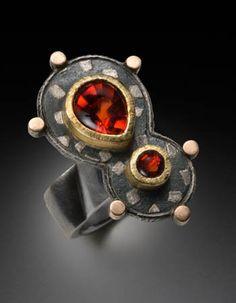 Nadine Kariya: Orange Exclamation Ring, Approx 3.5TCW spessartite garnets, 8k red gold, 18k yellow gold, and sterling silver shakudo. Size 8...