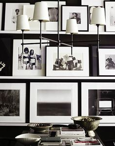 white, wide-margined frames against black walls. visually arresting. -h.