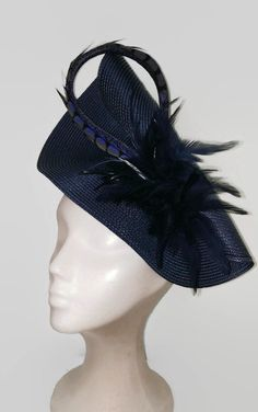 e9d4a3566fc Derby Hats · Beautiful navy blue feathers fascinator. The navy hat is  decorated with navy feathers and an