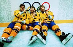 Hakan Loob, Mats Naslund and Tomas Jonsson celebrate Sweden's unlikely Gold Medal victory over Canada at the 1994 Olympic Winter Games in Lillehammer, Norway. The trio created history by being the first to have won the Stanley Cup, IIHF World Championship and Olympic Gold medal over the course of a playing career.