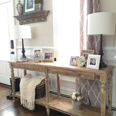 In love with the style of this foyer table!