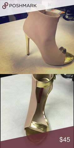 Women's Heel Sandals This shoe is tan in color with gold inset and a gold heel it's half and half one side is covered and the other side is bare leaving just enough to the imagination... Shoes Heels