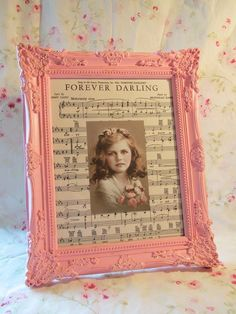 Painted frame with sheet music around picture