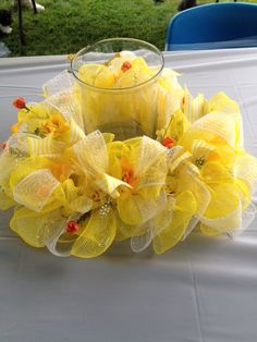 Spring centerpieces Hand made spring centerpiece with yellow deco mesh Other