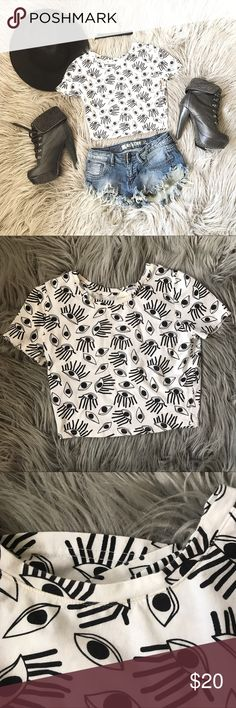 Eyes Crop Tee This shirt is versatile and can be worn in many ways! Great condition! It just has a minor flaw- slight make up stain on the neckline (as shown in pic) it's hardly noticeable. Pair with high waisted denim shorts and booties!! Add circle hat and Choker to complete the look 💖💖 not from urban outfitters! Only listed for more exposure Urban Outfitters Tops