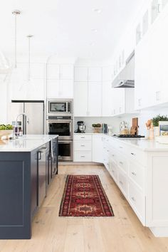 Studio McGee's latest project is everything we want in a kitchen and more. We love the extra-high ceilings with cabinets that extend all the way to the top. The navy island and beautiful...