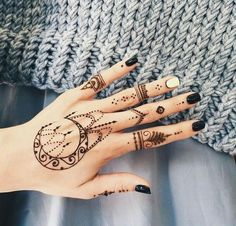Intricately stunning moon hand henna tattoo                                                                                                                                                                                 More