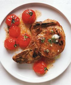 Grilled Pork Chops With Cherry Tomatoes and Garlic Butter | These surprisingly simple recipes yield tender, flavorful meals in 30 minutes or less.