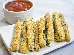 Baked Zucchini Fries: 1lb zucchini, 1/4c flour, 1/8t salt, 1c panko, 1/4c Parmesan, 1T Italian seasoning, 1 egg, Preheat oven 425, Cover baking sheet with foil, Place wire cooling rack on top, Rinse/dry zucchini, Cut ends off, Cut into 1/3in-thick strips, Place strips in bag, Add flour & salt, Shake, In shallow dish combine panko, cheese & seasoning, Stir, Whisk egg in 2nd dish, Dip strips into egg & then panko, Place evenly spaced onto baking sheet/rack, Bake 15min or until golden & serve.