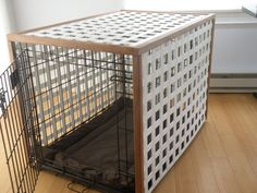 """Dog crate cover. We bought this black wire crate and I couldn't stand the way it looked. So I came up with this idea for a """"cover"""" of white square trellis and outside corner moulding. My husband built it and stained the wood to match our room. It looks so much better now!"""