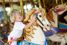"""Dollywood's carousel features 60 beautifully painted animals, including the lead horse that is lovingly referred to as """"Dolly"""" because of its flowing blonde mane. Smoky Mountains Attractions, Gatlinburg Cabin Rentals, Painted Pony, Kids Ride On, Carousel Horses, Train Rides, Georgia, Pigeon Forge, Park"""
