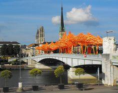 art installation (wood, concrete, & flourescent paint) by Arne Quinze over a bridge in Rouen, Normandy, France