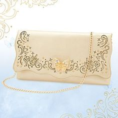Disney Cinderella Purse - Live Action Film | Disney StoreCinderella Purse - Live Action Film - Carry fairytale memories wherever you go with this elegant Cinderella Purse. Inspired by Disney's new live action movie, and fashioned in gold faux leather, it features a dazzling butterfly, and cut-out design with glitter detailing.