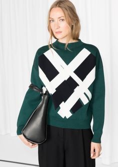 This dense cotton sweater is embellished with a captivating weave structure attached at front for added dimension and a stylish edge. $95