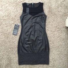 NWT. Black Bebe Dress NWT. Bebe. Size XS. Black mini dress. Sweetheart top with mesh detailing on the shoulder. Jeweled detailing on the bottom. bebe Dresses Mini