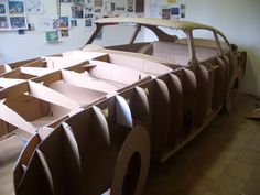 """Chris Gilmour: """"Aston Martin"""" (in construction) cardboard and glue - life size 2006"""
