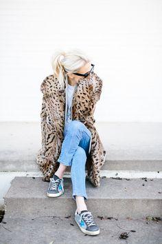 bradley agather in leopard coat and golden goose sneakers