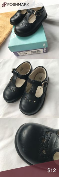 Stride Rite Navy T-strap, size 5 1/2 Stride Rite T-Strap Navy Lea shoes, size 5 1/2. Gently worn, but still in great condition. Small scuffs at the toes, but not very noticeable. Stride Rite Shoes Dress Shoes