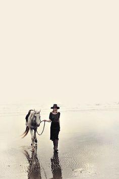 a horse and an ocean