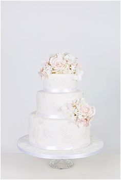 Vintage Princess - Decorated with edible sugar lace applique, pearls and delicately coloured sugar flowers #WeddingCakes www.finditforweddings.com