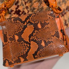 One of the most timeless handbag styles is coming back in a bold way for Fall. Whether real or faux, exotic prints — particularly different types of snakeskin — are showing up on bags in both natural tones and more saturated shades or orange, green, and red.