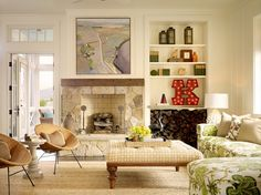 Cottage style living room. Styling with an off-center fireplace.