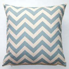 Etsy, $20.95.  (for just the pillow cover).  We can make this, pillow included, for less.  But this is what I was thinking of as far as blue with your rug.