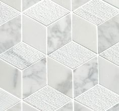 Carrara Cubed Marble tiles from  Mandarin Stone. This classic Italian marble mosaic combines honed, polished and subtly grooved finishes to give a dramatic '3D cube' effect. www.mandarinstone.com