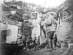 A Turkish officer is led blindfolded through the Anzac lines ...
