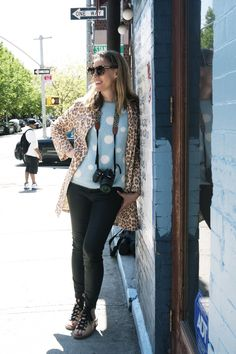 Dorenna Newton, TV producer and blogger at whatwelikenyc.com, wearing Acne shoes, Marc by Marc Jacobs trousers and coat, Karen Walker sunglasses and sweater from Brooklyn Fox in Williamsburg.