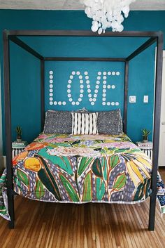 The wall decal above the bed gives this bedroom a playful vibe. Source: A Beautiful Mess