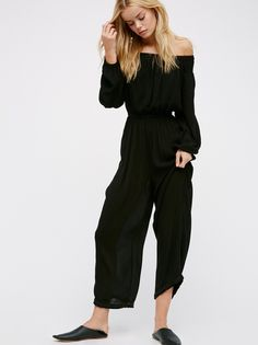 Show your Shoulder Romper | Relaxed romper with a semi-sheer, crinkly fabrication. Elastic at the waist, sleeve cuffs and femme off-the-shoulder neckline. Smocked bands at the shoulder. Flared leg features unfinished edges for a lived-in look. Front tasseled tie accent.