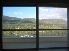 view from inside - large sliding glass windows - Armon and Sara's Place - A room with a view! - Galilee - rentals