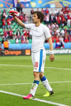 Tomas Rosicky of Czech Republic gives a supporter his shirt following the UEFA EURO 2016 Group D match between Czech Republic and Croatia at Stade Geoffroy-Guichard on June 17, 2016 in Saint-Etienne, France.