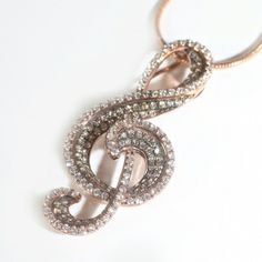 A stunning piece of 18ct rose gold jewellery in the shape of an