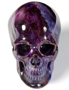 """Sugilite is a rare mineral that is not found in that many areas of the world. It is also known as """"Royal Lavulite"""" and """"Royal Azel."""" Melody, in here book Love is in the Earth, describes Sugilite as """"a love stone for this age"""" which represents all that is. Human Skull, Crystal Skull, Mineral Stone, Skull And Bones, Skull Art, Rocks And Minerals, Crystals And Gemstones, Skeletons, Crane"""