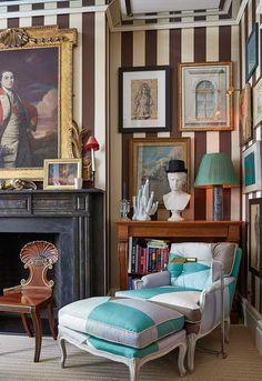 The walls of Miles' living room are upholstered in a striped silk