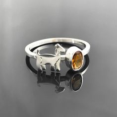 This sterling silver and citrine goat ring is the beautiful beginning of a new Collection! Combine your favorite animal with your favorite gemstone and turn them into an adorable sterling silver stacking ring! Make a custom order through Etsy to get your own perfect combination. Find this and more animal and gemstone jewelry in Sara Kear's Etsy shop.