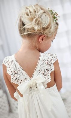 Can't help but smile about this boho flower girl dress. The sweet lace detail accompanied with that petite bow is so adorable. What do your flower girl dresses look like? Show us some cuteness.  #FlowerGirl #Boho #PSWeddingsAndEvents
