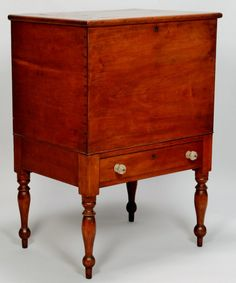 """Middle Tennessee sugar chest, Marshall or Maury County, cherry with poplar secondary. Dovetailed locking top case has brass escutcheon & hinged top with bread board ends & molded edges Single dovetailed drawer with brass escutcheon and 2 cut glass pulls. Tall turned tapered legs with ring turnings, terminating in ball and spike feet.  40""""H x 28""""W x 20-1/2""""D. Ca 1830. $5000"""