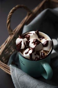 Good morning - A cup of coffee with milk, marshmallow, cinnamon and melted chocolate in the natural morning light