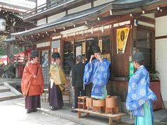 Shinto priests of the Shinto shrine. They are wearing kariginu