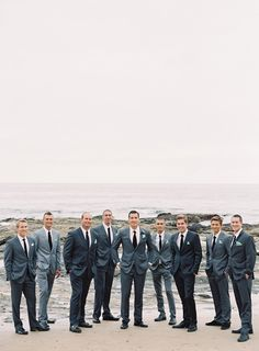 Elegant beach wedding...love the guys in different shades  by Michael Radford