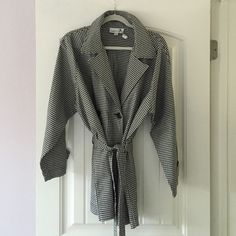 Karen Kane Gingham Raincoat This coat makes me want to go to Paris! Lightweight black and white gingham raincoat - excellent condition! Falls above knee to mid- thigh depending on your inseam/height. Karen Kane Jackets & Coats Trench Coats