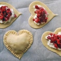 Valentine's Day treat.... Strawberries, sugar, cream cheese, and pie dough!