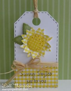 handmade tag from Stamping with Loll ...sunny yellow and white ... die cut sunflower with gingham petals ... raffia ribbon wrap and bow ... faux stitching around the edges ... like it!!
